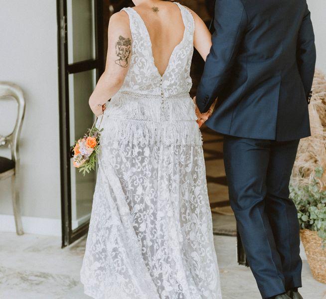 pareja-entrando-banquete-de-bodas-pazo